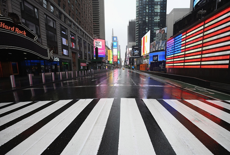 A nearly empty Times Square is seen on March 23, 2020 in New York City. © Photo by Angela Weiss / AFP) (Photo by ANGELA WEISS/AFP via Getty Images