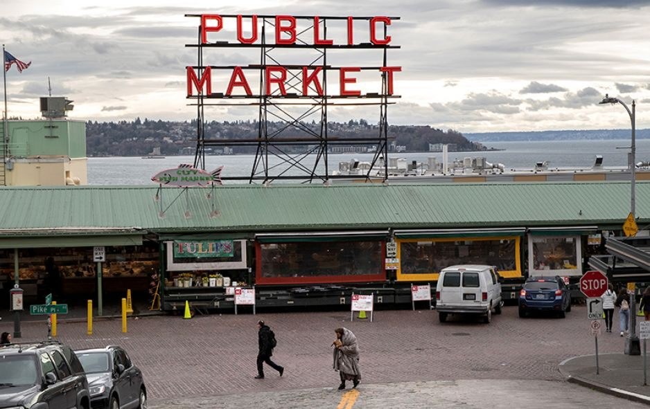 Seattle, Washington: The Pike Place Market standing virtually empty of patrons. The historic farmer's market is Seattle's most popular tourist attraction, and business has been especially hard hit by coronavirus fears. © Getty Images photo/John Moore