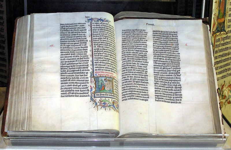 A Bible handwritten in Latin, on display in Malmesbury Abbey, Wiltshire, England. The Bible was written in Belgium in 1407 AD, for reading aloud in a monastery. Photo by Adrian Pingstone.